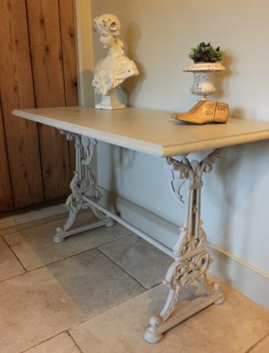 Painted Table with Ornate Cast Iron Base