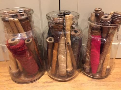 Antique Jar of old Mill Bobbins