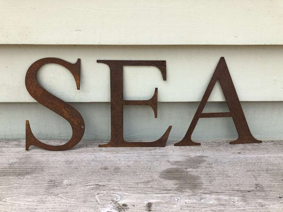 LARGE IRON LETTERS spelling SEA
